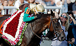 ARLINGTON HEIGHTS, IL - AUGUST 12: Jockey Jorge Vargas, Jr. hugs Postulation #7 after winning the American St. Ledger Stakes on Arlington Million Day at Arlington Park on August 12, 2017 in Arlington Heights, Illinois. (Photo by Jon Durr/Eclipse Sportswire/Getty Images)