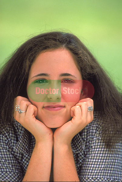 portrait of teenage girl with chin in hands