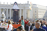 Faithful attend a Mass celebrated by the Pope for the canonization of the blessed Giovanni Enrico Newman, Giuseppina Vannini, Maria Teresa Chiramel Mankidiyan, Dulce Lopes Pontes and Margarita Bays, in St. Peter's Square at the Vatican, October 19, 2019. UPDATE IMAGES PRESS/Riccardo De Luca <br /> <br /> STRICTLY ONLY FOR EDITORIAL USE