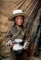 Tibetan Nomad Boy with teapot in Kham, Tibet 2005.