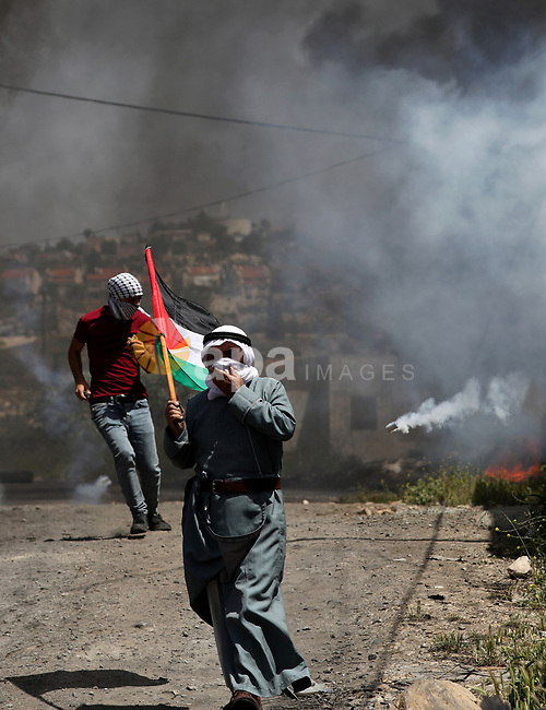 Palestinian protesters clash with Israeli security forces following a protest against the expropriation of Palestinian land by Israel in the West Bank village of Kafr Qaddum, near the northern city of Nablus on April 23, 2021. Photo by Shadi Jarar'ah