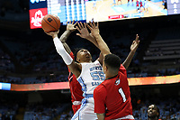 CHAPEL HILL, NC - NOVEMBER 01: Christian Keeling #55 of the University of North Carolina shoots over Robert Colon #1 of Winston-Salem State University during a game between Winston-Salem State University and University of North Carolina at Dean E. Smith Center on November 01, 2019 in Chapel Hill, North Carolina.