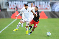WASHINGTON, DC - MARCH 07: Nicolas Figal #5 of Inter Miami CF battles the ball with Edison Flores #10 of D.C. United during a game between Inter Miami CF and D.C. United at Audi Field on March 07, 2020 in Washington, DC.
