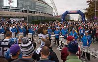 26.10.2014.  London, England.  NFL International Series. Atlanta Falcons versus Detroit Lions. Lions drum band with the Lions Mascot outside Wembley Stadium.