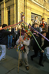 May Day first of May Oxford, man with mobile maypole gets students to celebrate by performing an impromptu maypole dance.  UK 1990s 1995
