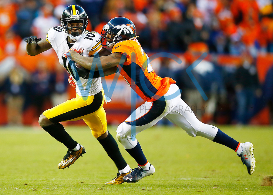 Martavis Bryant #10 of the Pittsburgh Steelers runs with the ball while attempting to evade a tackle from Aqib Talib #21 of the Denver Broncos in the second half against the Denver Broncos during the AFC Divisional Round Playoff game at Sports Authority Field at Mile High on January 17, 2016 in Denver, Colorado. (Photo by Jared Wickerham/DKPittsburghSports)