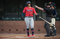 Jacksonville Jumbo Shrimp Joe Dunand (3) reacts to getting hit by a pitch as umpire Matt Winter awards first base during a Southern League game against the Mobile BayBears on May 8, 2019 at Hank Aaron Stadium in Mobile, Alabama.  Jacksonville defeated Mobile 7-1.  (Mike Janes/Four Seam Images)