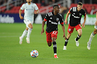 WASHINGTON, DC - MAY 13: Moses Nyeman #27 of D.C. United dribbles the ball during a game between Chicago Fire FC and D.C. United at Audi FIeld on May 13, 2021 in Washington, DC.