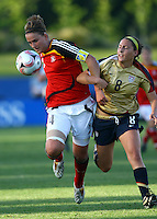 Valeria Kleiner (GER) and Vicki DiMartino (USA) compete for the ball..FIFA U17 Women's World Cup, Semi Final, Germany v USA, QEII Stadium, Christchurch, New Zealand, Thursday 13 November 2008. Photo: Renee McKay/PHOTOSPORT