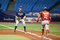 Tampa Bay Rays Joe McCarthy (31) waits for a throw as Jeremy Rivera (11) runs to first during an instructional league game against the Boston Red Sox on September 24, 2015 at Tropicana Field in St Petersburg, Florida.  (Mike Janes/Four Seam Images)