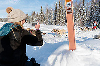 A race fan takes a photo of Aliy Zirkle on Long Lake during the Official Re-Start of the 2018 Iditarod Sled Dog Race in Willow, Alaska on March 04, 2018. <br /> <br /> Photo by Jeff Schultz/SchultzPhoto.com  (C) 2018  ALL RIGHTS RESERVED