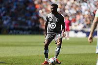 ST. PAUL, MN - AUGUST 21: Bakaye Dibassy #12 of Minnesota United FC with the ball during a game between Sporting Kansas City and Minnesota United FC at Allianz Field on August 21, 2021 in St. Paul, Minnesota.