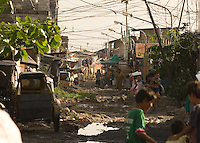 """The Basico port area slum of Manila, the """"kindey market where over 300 men have sold their kidneys.  All recieved between 70,000 -  90,000 pesos (800 - 1030 pounds).  More than 300 have sold their kidneys in this slum of 16,000 people.<br /> <br /> PHORO BY RICHARD JONES"""