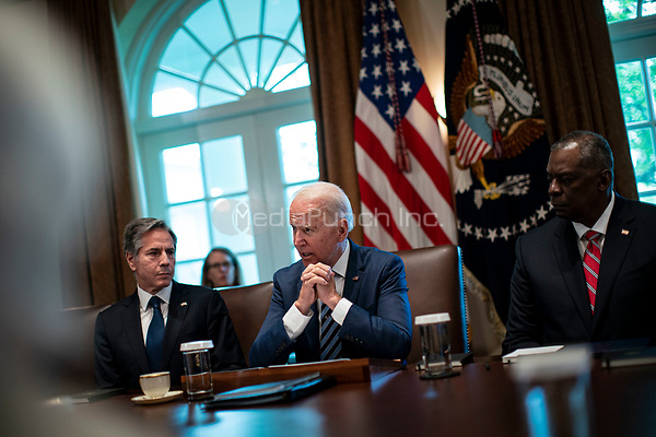 United States President Joe Biden speaks as US Secretary of State Antony Blinken, left, and US Secretary of Defense Lloyd J. Austin III, right, listen during a cabinet meeting at the White House in Washington, D.C., U.S., on Tuesday, July 20, 2021. Biden administration officials say they're starting to see signs of relief for the global semiconductor supply shortage, including commitments from manufacturers to make more automotive-grade chips for car companies. <br /> Credit: Al Drago / Pool via CNP /MediaPunch