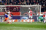 Nederland, Amsterdam, 7 februari 2016<br /> Eredivisie<br /> Seizoen 2015-2016<br /> De Klassieker <br /> Ajax-Feyenoord<br /> Jens Toornstra (l.) van Feyenoord scoort de 0-1. Joel Veltman en Mike van der Hoorn van Ajax balen.