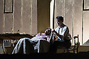 London, UK. 27.10.2014. Jonathan Miller's production, for English National Opera, of LA BOHEME, by Giacomo Puccini, opens at the London Coliseum. Rising star soprano, Angel Blue, makes her role debut as Mimi. Picture shows: Angel Blue (Mimi), David Butt Philip (Rodolfo). Photograph © Jane Hobson.
