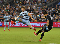 KANSAS CITY, KS - JULY 31: Wilson Harris #96 of Sporting Kansas City tries to block Jimmy Maurer #20 of FC Dallas as he boots the ball upfield during a game between FC Dallas and Sporting Kansas City at Children's Mercy Park on July 31, 2021 in Kansas City, Kansas.