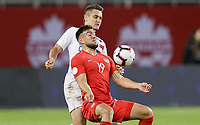 TORONTO, ON - OCTOBER 15: Lucas Cavallini #19 of Canada and Aaron Long #23 of the United States battle for a ball during a game between Canada and USMNT at BMO Field on October 15, 2019 in Toronto, Canada.