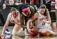 COLLEGE PARK, MD - FEBRUARY 03: Faith Masonius #13 and Taylor Mikesell #11 of Maryland in  scrimmage for the ball with Nia Clouden #24 of Michigan State during a game between Michigan State and Maryland at Xfinity Center on February 03, 2020 in College Park, Maryland.