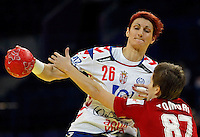 BELGRADE, SERBIA - DECEMBER 16:  Biljana Filipovic (L) of Serbia is challenged by Zsuzsanna Tomori (R) of Hungary during the Women's European Handball Championship 2012 third place match between Hungary and Serbia at Arena Hall on December 16, 2012 in Belgrade, Serbia. (Photo by Srdjan Stevanovic/Getty Images)