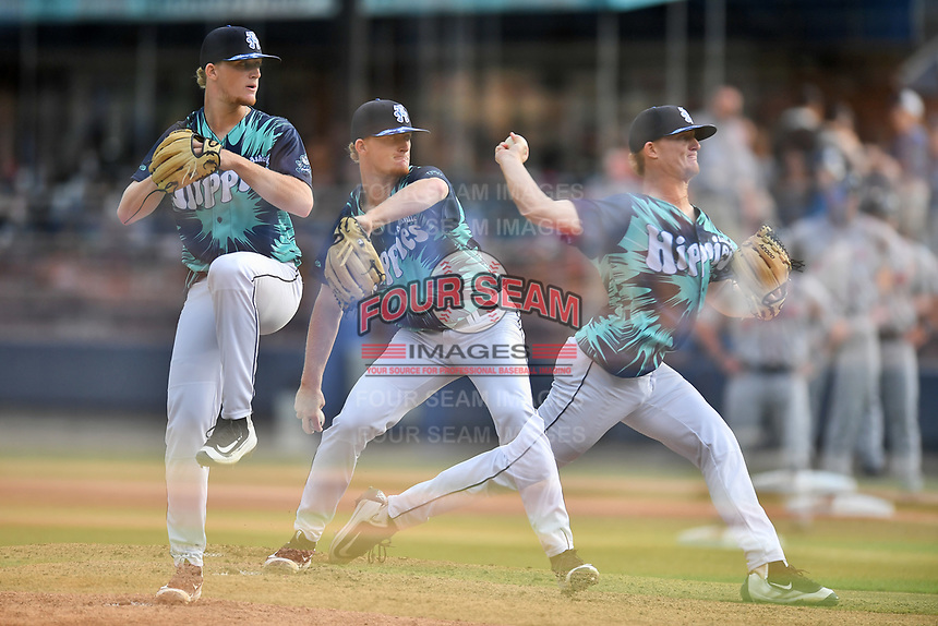 Asheville Tourists starting pitcher Shelby Lackey (10) delivers a pitch in an in-camera multiple exposure during a game against the Greenville Drive on Hippie Night at McCormick Field on July 11, 2019 in Asheville, North Carolina. The Drive defeated the Tourists 6-2. (Tony Farlow/Four Seam Images)