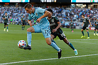 ST PAUL, MN - AUGUST 14: Ethan Finlay #13 of Minnesota United FC with the ball on the end line during a game between Los Angeles Galaxy and Minnesota United FC at Allianz Field on August 14, 2021 in St Paul, Minnesota.
