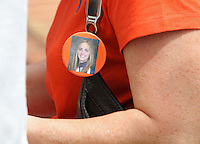 Fans wore memorial ribbons and buttons to the first University of Virginia women's lacrosse game since the tragic death of teammate Yeardley Love Sunday May 16, 2010 at Klockner Stadium in Charlottesville, Va. The Cavaliers rallied in the last four minutes to beat Towson 14-12 and reach the quarter finals of the NCAA tournament. Love's body was found May 3, and Virginia men's lacrosse player George Huguely is charged with murder. Photo/Andrew Shurtleff..