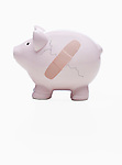USA, Illinois, Metamora, Piggy bank with crack and bandage