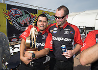 Apr. 28, 2013; Baytown, TX, USA: Crew members for NHRA funny car driver Cruz Pedregon celebrate after winning the Spring Nationals at Royal Purple Raceway. Mandatory Credit: Mark J. Rebilas-