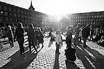 People enjoy the winter afternoon sun in La Plaza Mayor in Madrid, Spain. Feb. 22, 2009.