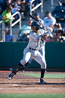 Tri-City Dust Devils shortstop Kelvin Alarcon (1) at bat during a Northwest League game against the Everett AquaSox at Everett Memorial Stadium on September 3, 2018 in Everett, Washington. The Everett AquaSox defeated the Tri-City Dust Devils by a score of 8-3. (Zachary Lucy/Four Seam Images)