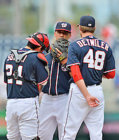 3 September 2012: Washington Nationals shortstop Ian Desmond participates in a mound conference with pitcher Ross Detwiler and catcher Kurt Suzuki during a game against the Chicago Cubs at Nationals Park in Washington, DC. The Nationals edged out the visiting Cubs 2-1, in the first game of heir 4-game series. Mandatory Credit: Ed Wolfstein Photo