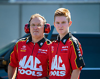 Sep 23, 2018; Madison, IL, USA; NHRA top fuel driver Doug Kalitta (left) with son Mitchell Kalitta during the Midwest Nationals at Gateway Motorsports Park. Mandatory Credit: Mark J. Rebilas-USA TODAY Sports