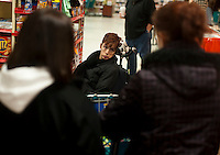 Kara directs her personal assistants during a trip to the supermarket. Photo by James R. Evans ©