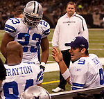 December 2009: Dallas Cowboys quarterback Tony Romo (9) talks with WR Patrick Crayton and rb Tashard Choice (23) during an NFL football game at the Louisiana Superdome in New Orleans.  The Cowboys defeated the Saints 24-17.
