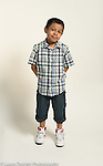 portrait of 7 year old boy, standing, full length