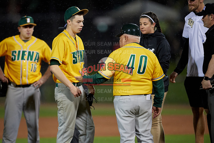 Siena Saints pitcher Mike McCully (18) talks with head coach Tony Rossi (40) during a game against the UCF Knights on February 14, 2020 at John Euliano Park in Orlando, Florida.  UCF defeated Siena 2-1.  (Mike Janes/Four Seam Images)