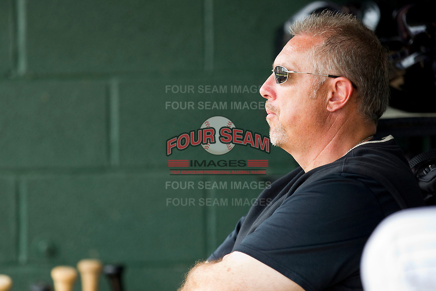 """Trainer Scott """"Fargo"""" Johnson watches the action against the West Virginia Power from the home dugout at Fieldcrest Cannon Stadium on April 20, 2011 in Kannapolis, North Carolina.   Photo by Brian Westerholt / Four Seam Images"""