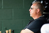 "Trainer Scott ""Fargo"" Johnson watches the action against the West Virginia Power from the home dugout at Fieldcrest Cannon Stadium on April 20, 2011 in Kannapolis, North Carolina.   Photo by Brian Westerholt / Four Seam Images"