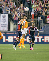 Houston Dynamo midfielder Giles Barnes (23) and New England Revolution defender A.J. Soares (5) compete for a head ball.  The New England Revolution played to a 1-1 draw against the Houston Dynamo during a Major League Soccer (MLS) match at Gillette Stadium in Foxborough, MA on September 28, 2013.