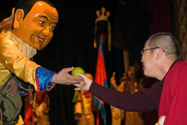DANCER  and MONK during MONGOLIAN NIGHT at a DALAI LAMA teaching in October 2007 sponsored by KUMBUM CHAMTSE LING & the TIBETAN CULTURAL CENTER - BLOOMINGTON, INDIANA