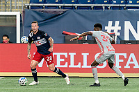 FOXBOROUGH, MA - AUGUST 29: Alexander Buttner #28 of New England Revolution looks to pass as Mandela Egbo #39 of New York Red Bulls closes during a game between New York Red Bulls and New England Revolution at Gillette Stadium on August 29, 2020 in Foxborough, Massachusetts.