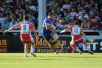 20130801 Copyright onEdition 2013 ©<br /> Free for editorial use image, please credit: onEdition.<br /> <br /> Alafoti Fa'osiliva of Bath Rugby 7s looks for space between Rhodri McAtee (left) and Drew Cheshire of Gloucester Rugby 7s during the J.P. Morgan Asset Management Premiership Rugby 7s Series.<br /> <br /> The J.P. Morgan Asset Management Premiership Rugby 7s Series kicks off for the fourth season on Thursday 1st August with Pool A at Kingsholm, Gloucester with Pool B being played at Franklin's Gardens, Northampton on Friday 2nd August, Pool C at Allianz Park, Saracens home ground, on Saturday 3rd August and the Final being played at The Recreation Ground, Bath on Friday 9th August. The innovative tournament, which involves all 12 Premiership Rugby clubs, offers a fantastic platform for some of the country's finest young athletes to be exposed to the excitement, pressures and skills required to compete at an elite level.<br /> <br /> The 12 Premiership Rugby clubs are divided into three groups for the tournament, with the winner and runner up of each regional event going through to the Final. There are six games each evening, with each match consisting of two 7 minute halves with a 2 minute break at half time.<br /> <br /> For additional images please go to: http://www.w-w-i.com/jp_morgan_premiership_sevens/<br /> <br /> For press contacts contact: Beth Begg at brandRapport on D: +44 (0)20 7932 5813 M: +44 (0)7900 88231 E: BBegg@brand-rapport.com<br /> <br /> If you require a higher resolution image or you have any other onEdition photographic enquiries, please contact onEdition on 0845 900 2 900 or email info@onEdition.com<br /> This image is copyright the onEdition 2013©.<br /> <br /> This image has been supplied by onEdition and must be credited onEdition. The author is asserting his full Moral rights in relation to the publication of this image. Rights for onward transmission of any image or file is not granted or implied. Changing or deleting Copyright information is illegal as specified in the Copyright, Design and Patents Act 1988. If you are