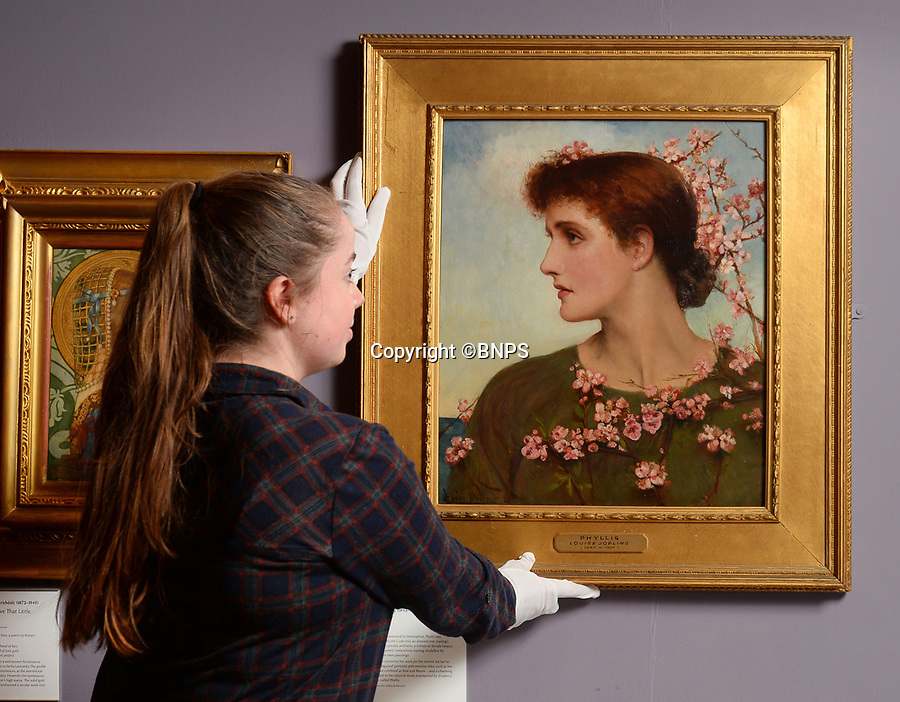 BNPS.co.uk (01202 558833)<br /> Pic: ZacharyCulpin/BNPS<br /> <br /> Pictured: Gallery technician with a Louise Jopling painting from 1883 entitled ' Phyllis'.<br /> <br /> A Pre-Raphaelite exhibition opens today at the Russell Coates Gallery in Bournemouth. <br /> <br /> Beyond the Brotherhood: The Pre-Raphaelite Legacy exhibition highlights its beginings, the importance of the Pre-Raphaelite movement all the way to the high fantasty art of the Lord of the Rings and Game of Thrones. <br /> <br /> In partnership with Southampton City Art Gallery and featuring loans from the Victoria and Albert Museum, the Royal Academy, Tate Britan the exhibition and runs until 21st June