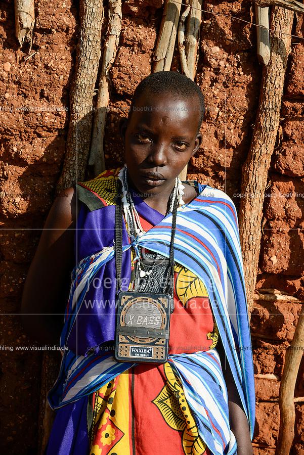 TANZANIA, Korogwe, Massai in Kwalukonge village, woman with chinese radio X-Bass / TANSANIA, Korogwe, Massai im Dorf Kwalukonge, Frau mit chinesischem Radio X Bass