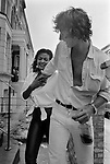 Man putting his hand down his  girl friends shirt top. She is restraining him. Both are drunk sexual advance playing around he is groping his girlfriend 1981 during the Notting Hill Carnival. 1980s