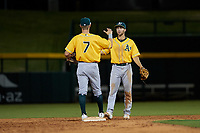 AZL Athletics Gold infielders Marty Bechina (7) and Michael Woodworth (1) celebrate a victory after an Arizona League game against the AZL Cubs 1 at Sloan Park on June 20, 2019 in Mesa, Arizona. AZL Athletics Gold defeated AZL Cubs 1 21-3. (Zachary Lucy/Four Seam Images)