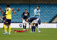 31st October 2020; The Den, Bermondsey, London, England; English Championship Football, Millwall Football Club versus Huddersfield Town; Murray Wallace of Millwall laying a poppy wreath in the centre circle