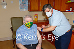 Waterville Stalwart Mick O'Dwyer in for his Pfizer-BioNTech vaccine at the Medical Centre in Waterville on Saturday, pictured here with Dr. Attila Adamik.