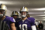Jake Locker (#10), University of Washington quarterback, walks down the tunnel prior to the start of the Huskies annual Apple Cup rivalry game against the Washington State Cougars on November 28, 2009.